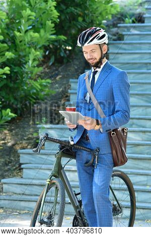 Bearded Businessman With Bicycle Holding Coffee Cup And Digital Tablet. Business And Alternative Tra