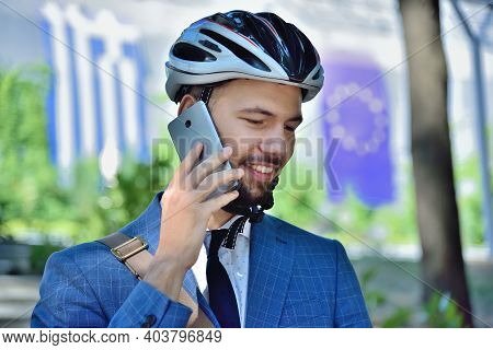 Bearded Businessman  Talking On Mobile Phone And Analyzes Report. Business And Urban Style Concept