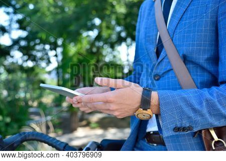 Businessman Using Digital Tablet Computer In Park. Business And Working Concept. Close Up.