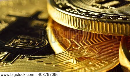 Golden Cryptocurrencys Bitcoin. Virtual Money And Cryptocurrency Concept. Close Up