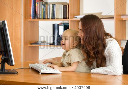 Mother With Kid Looking Monitor