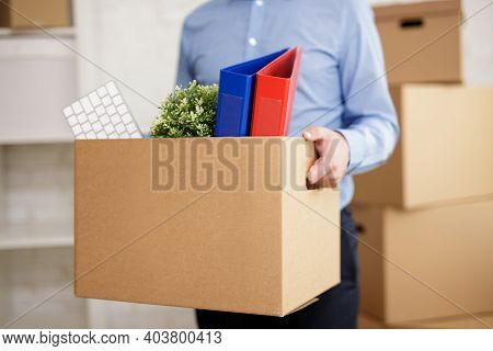 Moving To New Office - Close Up Of Male Hands Holding Cardboard Box With Office Things
