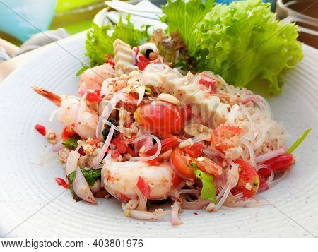 Close Up Of Spicy Seafood Mixed Vermicelli Salad With Vegetable In A White Plate