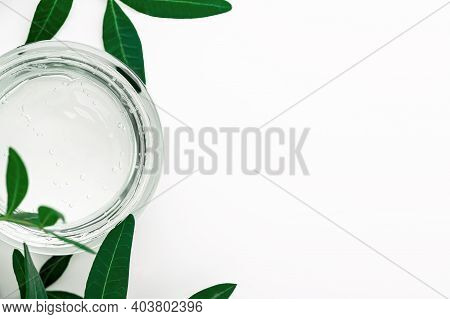Gel Cream Texture With Bubbles On White Background Close-up Top View. Eco-friendly Moisturizing Herb