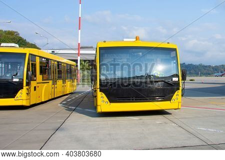 Shuttle Yellow Buses To Transport Passengers From The Terminal Building To The Aircraft