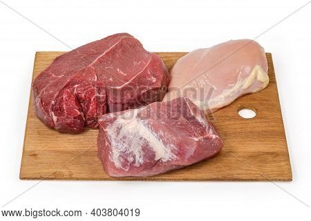 Big Pieces Of The Various Uncooked Boneless Meat - Skinless Chicken Breast, Pork And Beef From The C