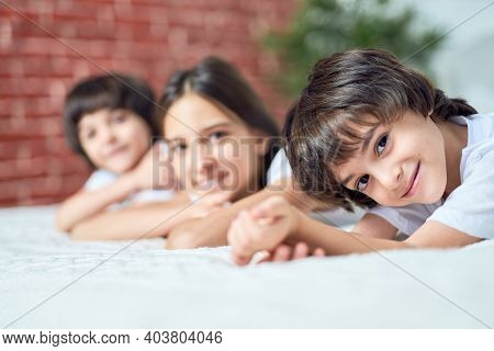 Happy Child. Portrait Of Joyful Little Latin Boy Looking At Camera. Brother Spending Time With His S