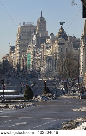 Madrid, Spain - January 17, 2021: General View Of Alcalá And Gran Vía Streets With The Metropolis Bu