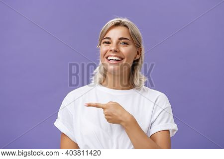 Close-up Shot Of Amused Happy And Entertained Good-looking Sociable Woman With Fair Hair And Beautif