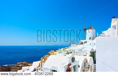 Santorini landscape. Panoramic view of Oia town by the sea, Greece