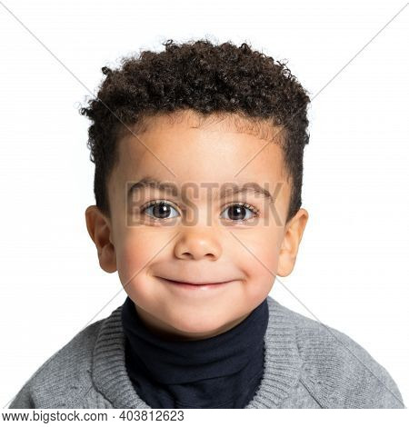 Close Up Studio Portrait  Of Cute Little Afro American Boy Looking At Camera. Kid With Afro Hairstyl