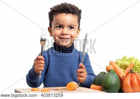 Close Up Portrait Of Little Afro American Kid Holding Knife And Fork Next To Bowl With Vegetables.bo