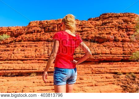 Tourism In Northern Territory Nt, Australia. Tourist Woman Looking Tall, Rugged Vertical Rock Walls