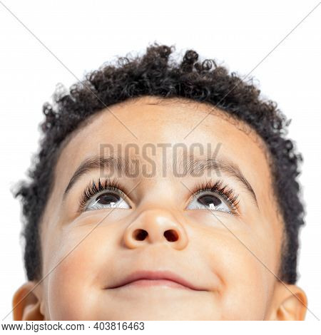 Macro Close Up Portrait Of Cute Little Afro American Boy Looking Up. Isolated On White Background.