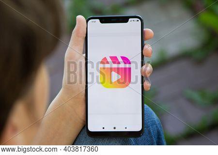 Girl hold SmartPhone displaying the Instagram reels logo. Social media. Instagram is a photo-sharing app. Belgorod , Russia - JUN, 10, 2020: