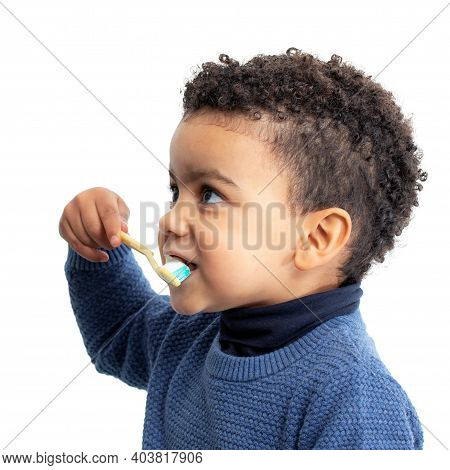 Close Up Side View Portrait Of Little Afro American Boy Brushing Teeth. Isolated Against White Backg
