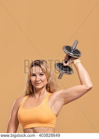 Strong Athlete Exercising For Muscles And Strength Workout. Friendly Muscular Adult Woman In Sports