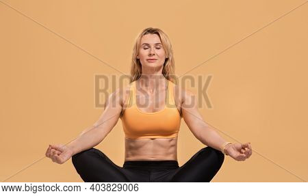 Meditation, Yoga, Rest, Sport And Beauty Body. Muscular Adult Woman In Sportswear With Closed Eyes S