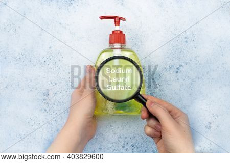 A Bottle Of Liquid Soap Floating In Soapy Water. Harmful Ingredients, Detergent With Sodium Lauryl S