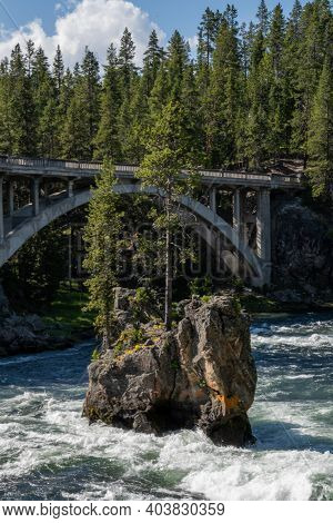Island And Arching Bridge In Yellowstone National Park