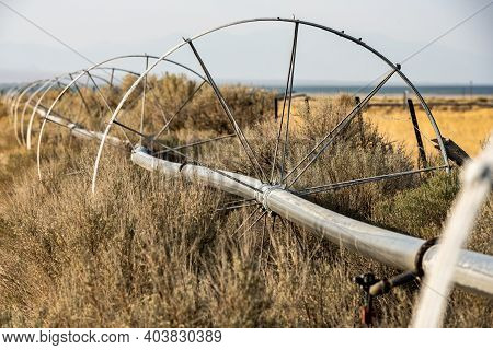 Irrigation System Spreads Across Dry Field In Nevada Valley In Great Basin National Park