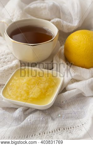 Healthy Bowl Of Pure Honey With Honey Dipper And Lemon Fruit And Puree On Vintage White Background.