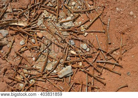 Rusty And Bent Used Nails Thrown On Dirt And Gravel Floors  Used Rusty And Crooked Nails Thrown On E
