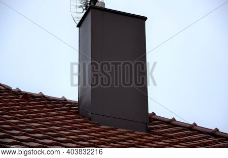 Plating The Chimney On The Roof Of Burnt Tiles. Chimney Protection Against Rain, Frost And Snow With