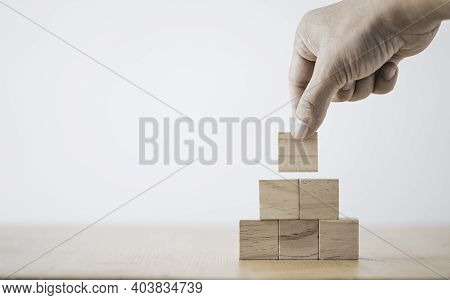 Hand Putting And Stacking Blank Wooden Cubes On Table With Copy Space For Input Wording And Infograp