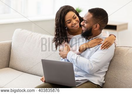 Happy Loving Family. Cheerful African American Couple Spending Time Together, Looking At Each Other,