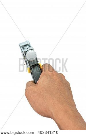 A Male Hand Holds A Construction Stapler On A White Background.