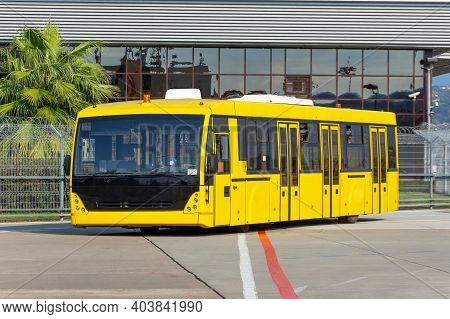 Shuttle Yellow Buse To Transport Passengers From The Terminal Building To The Aircraft