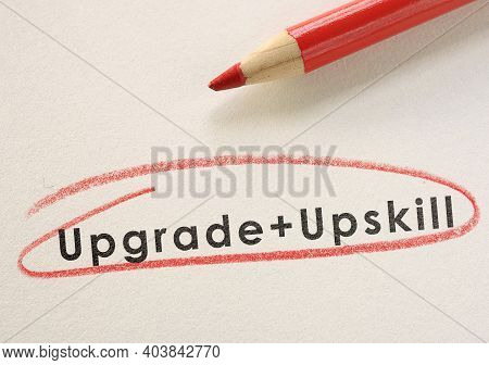 Upgrade And Upskill Text Circled In Red Pencil -- Job Training Concept