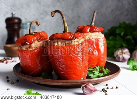The Traditional Dish Is Stuffed Peppers With Pork And Rice On A Light Concrete Background.