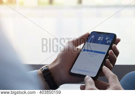 Chiang Mai ,thailand Jan 17 2021 : Woman Holding A Iphone X With Social Internet Service Facebook On