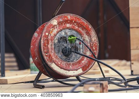 Close Up Of An Old, Dirty, Red Cable Reel