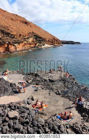 Tenerife, Spain - October 25, 2012: Tourists Visit Coast In Costa Del Silencio In Tenerife. Spain Is
