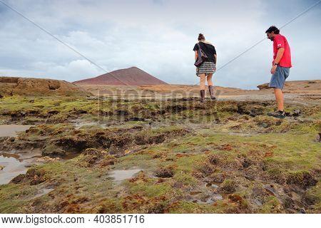 Tenerife, Spain - October 28, 2012: Tourists Visit Medano Beach In Costa Del Silencio In Tenerife. S