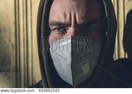 Portrait Of A Young Man With A Ffp3 Corona Mask