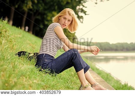 Summer Vacation. Girl Relaxing At Riverside After Working Day. Woman Dreaming About Vacation. Rest R