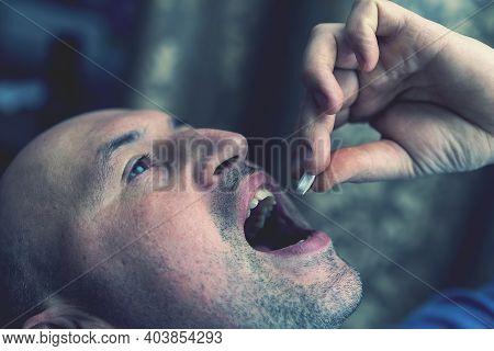 Extreme Closeup Man Face Taking White Pill, Mouth View Swallowing Pills, Illness. Man Take Medicine,