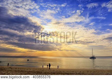 Beautiful Sunset Over The Clam Sea With Cloud And Sky Background. Sunset Over Tropical Beach. Nature