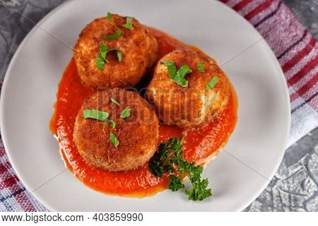 Italian Arancini - Rice Balls Stuffed With Cheese And Tomato Sauce In A Plate On An Old Wooden Table