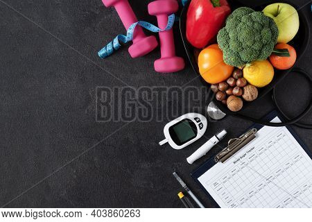 Healthy Eating And Sport Plan For Diabetes Patients Top View On Black Background. Diabetes Concept B