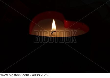 Isolated Candle With Hearts. Red Ribbon. A Burning Candle. A Bright Flame. Decorative Candle