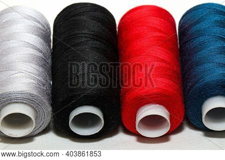 Colored Threads And Needles. Everything You Need For Sewing. Several Spools Of Thread. Sharp Needles