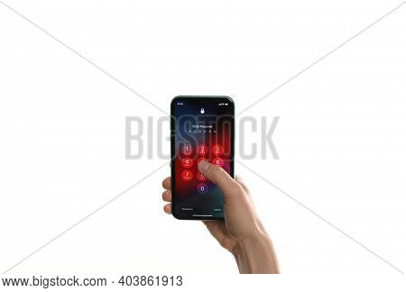 Mykolaiv, Ukraine - July 9, 2020: Woman Holding Iphone 11 With Lock Screen On White Background, Clos