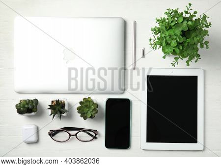 Mykolaiv, Ukraine - July 10, 2020: Flat Lay Composition With Iphone 11, Macbook Laptop And Ipad Tabl