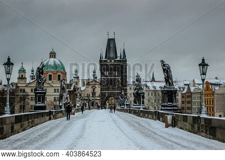 Prague, Czech Republic - January 14, 2021. Charles Bridge, Old Town Bridge Tower Covered With Snow.