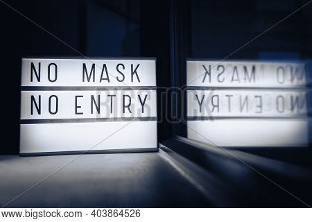 NO MASK NO ENTRY. Covid-19 mask wearing mandatory in many countries when going in retail shops or grocery stores. Coronavirus protection obligatory restriction.
